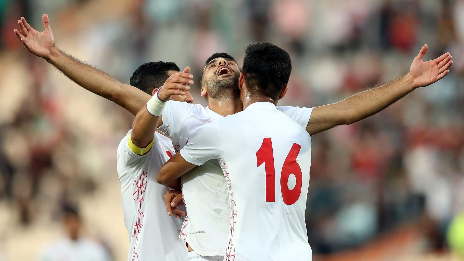Mehdi Taremi of Iran celebrates their third goal