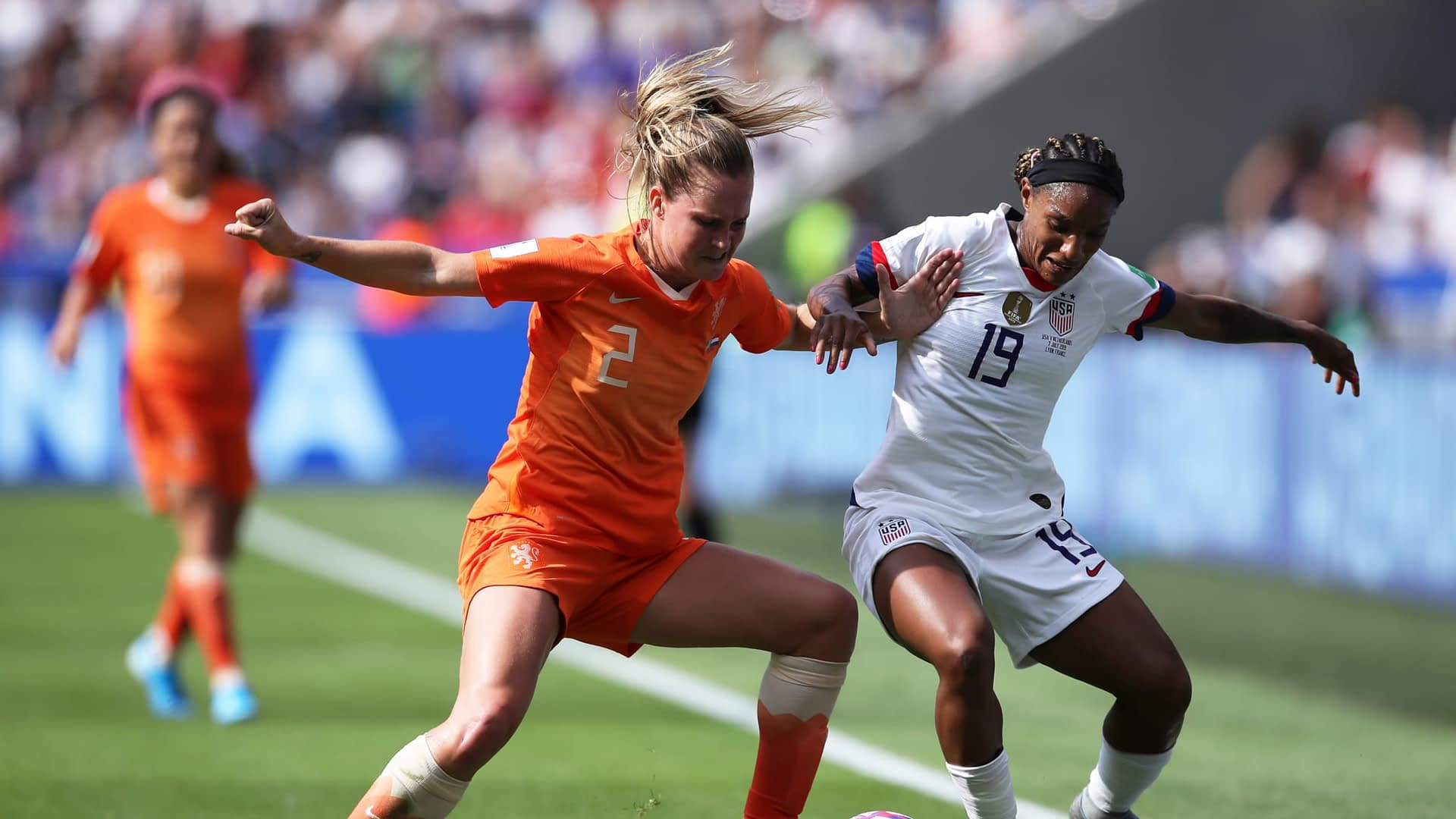 Desiree Van Lunteren of the Netherlands is challenged by Crystal Dunn of the USA